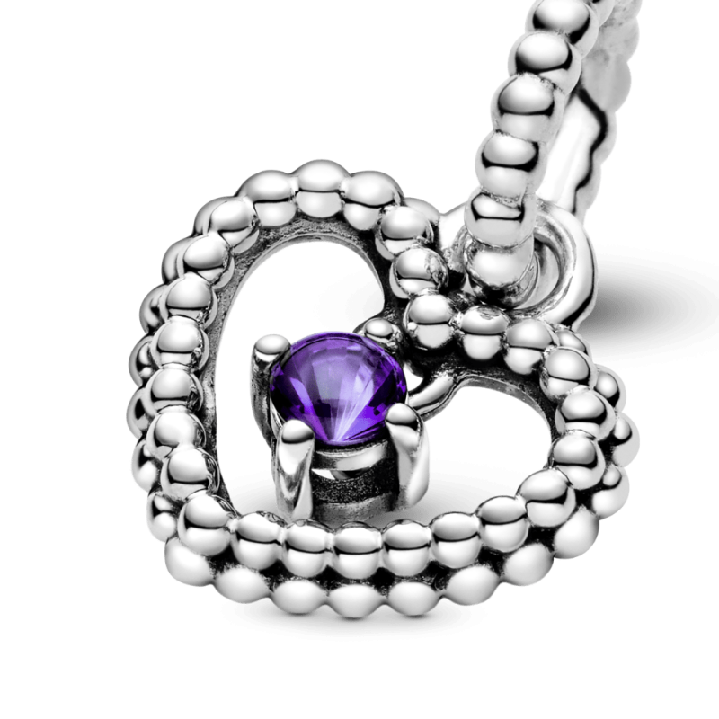 Висечки приврзок во форма на срце со перли и со пурпурен кристал